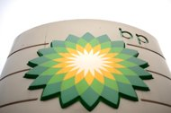 BP profits slide on lower oil output