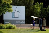 Facebook falls flat in market debut