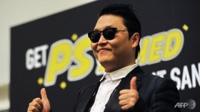 Gatecrasher style: Psy impersonator fools Cannes