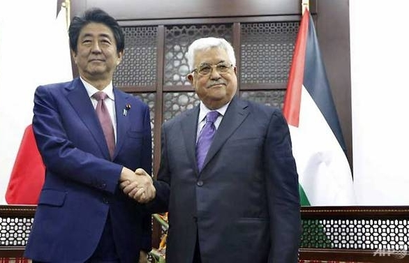 Japanese PM pledges not to move its Israeli embassy