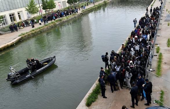 Police clear Paris camp as migrant debate flares in France
