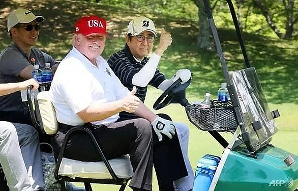 After sumo and golf, Trump and Abe get down to business