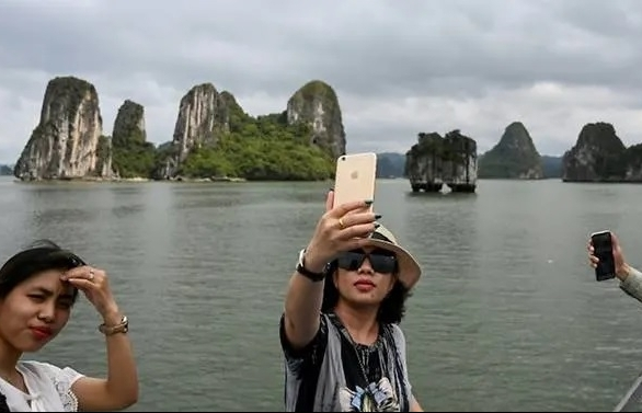 Tourists back in Vietnam's Ha Long Bay as domestic travel restarts after easing of COVID-19 measures