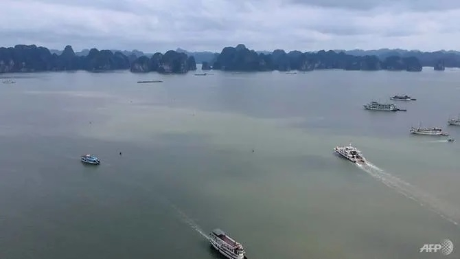 tourists back in vietnams ha long bay as domestic travel restarts after easing of covid 19 measures