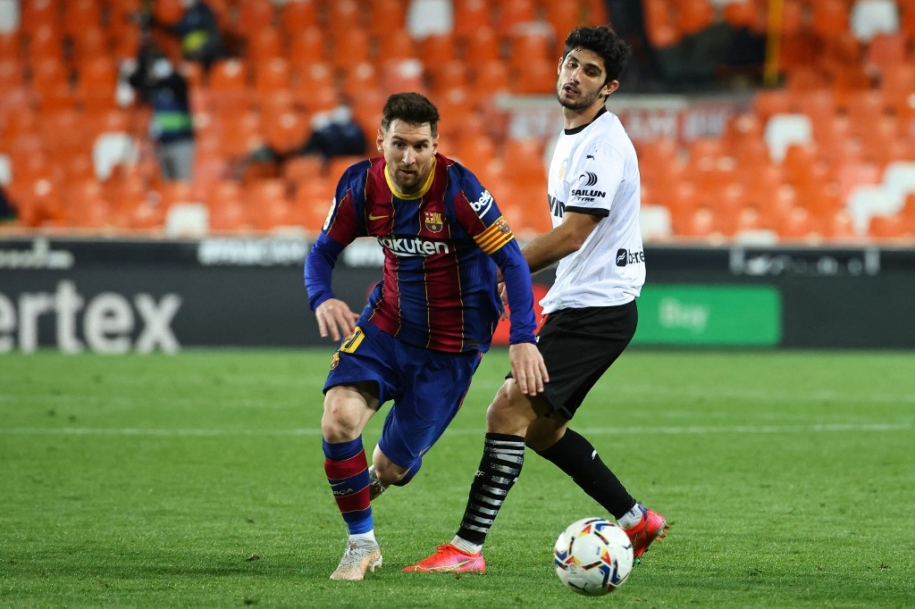 messi double leads barca to nail biting win over valencia