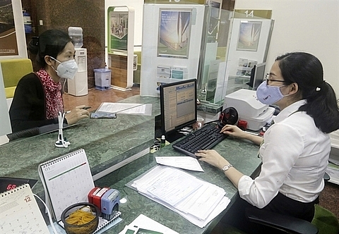 credit institutions asked to tighten loans in overheating sectors sbv