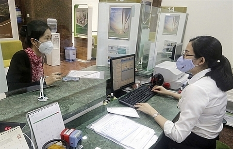 """Credit institutions asked to tighten loans in """"overheating"""" sectors: SBV"""