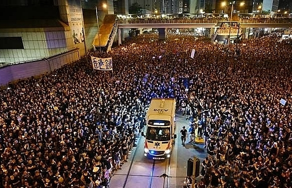 hong kong leader apologises after 2 million protesters take to streets