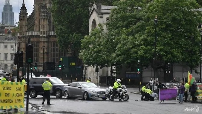 British PM Johnson's car hit in collision outside parliament