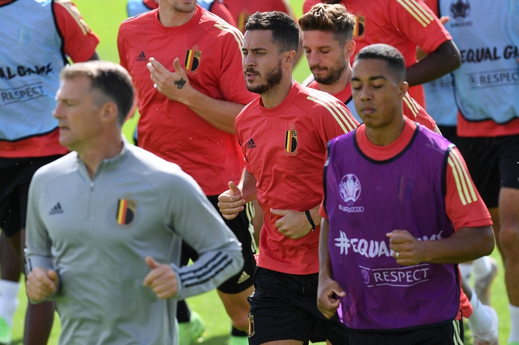 Belgium's forward Eden Hazard (C) runs with teammates during their MD-1 training session at the team's base camp at the Belgian National Football Centre in Tubize on June 10, 2021 on the eve of the UEFA EURO 2020 group B football match between Finland and Belgium. JOHN THYS / AFP