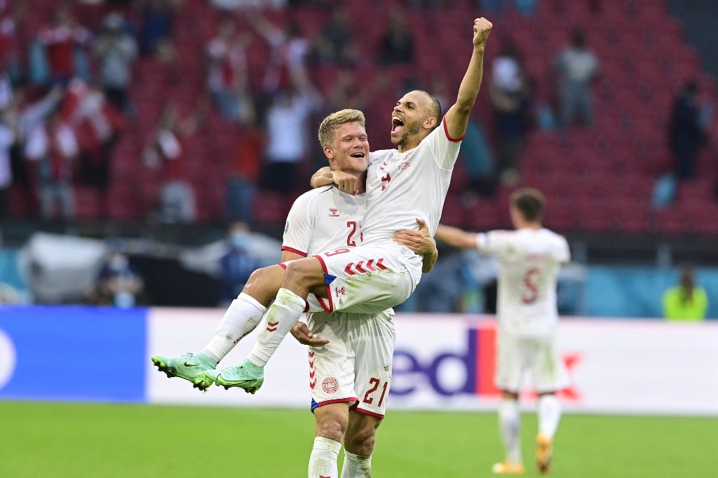 Denmark's forward Andreas Cornelius (L) and Denmark's forward Martin Braithwaite (R) celebrate at the end of the UEFA EURO 2020 round of 16 football match between Wales and Denmark at the Johan Cruyff Arena in Amsterdam on June 26, 2021. Olaf Kraak / POOL / AFP