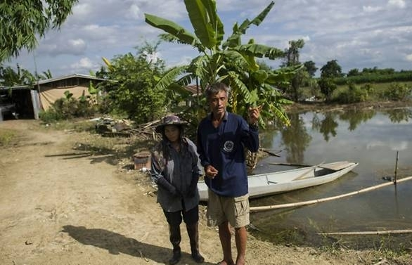 Fields submerged, livestock killed, but farmers happy to help clear exit for boys in cave