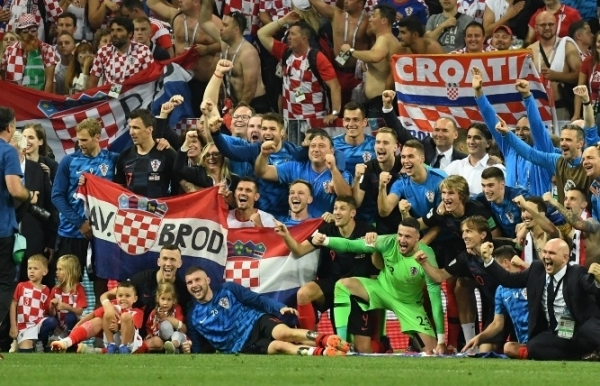 World Cup: Croatia reach first final as England pain goes on                                1