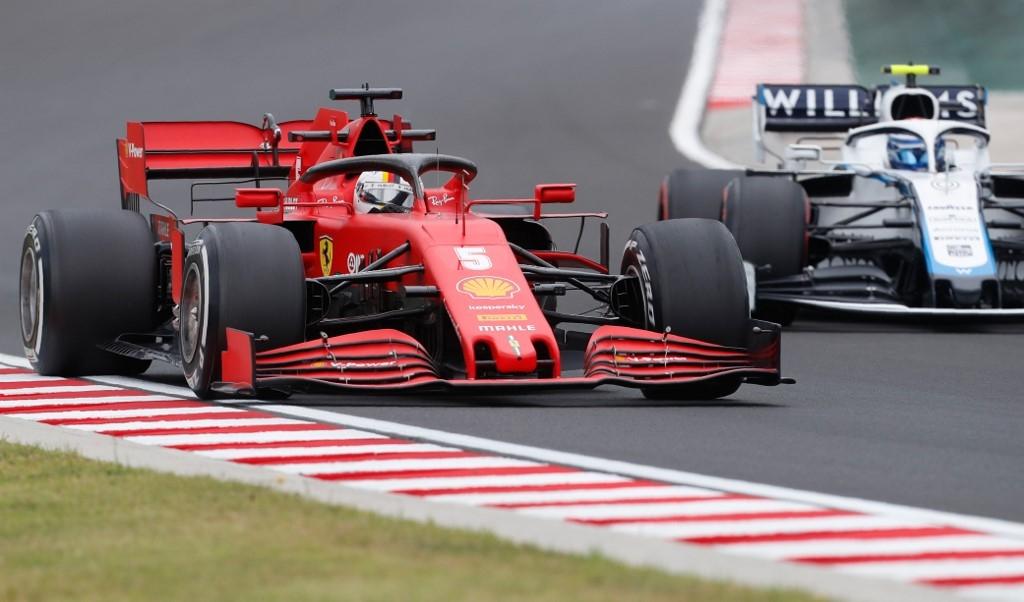 Vettel shines in wet Hungarian practice as Hamilton takes rain check