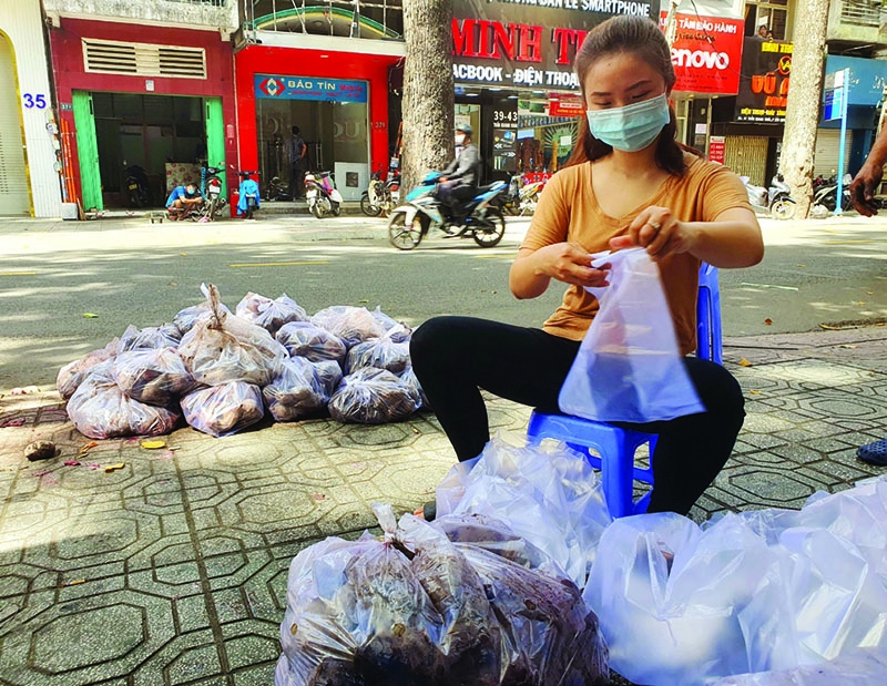 Latest outbreak flips lives upside down in Ho Chi Minh city