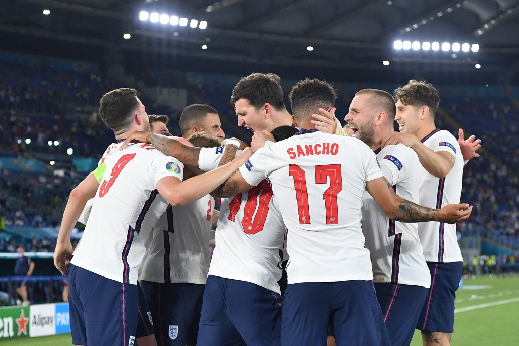 England's players celebrate their third goal during the UEFA EURO 2020 quarter-final football match between Ukraine and England at the Olympic Stadium in Rome on July 3, 2021. Ettore Ferrari / POOL / AFP