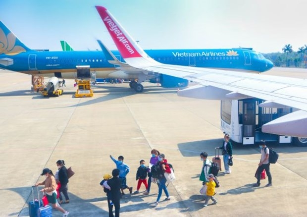 Tho Xuan Airport in Thanh Hoa province. Vietnam Airlines and Vietjet Air have deployed the IATA Travel Pass, an electronic health passport application. (Photo: VNA)