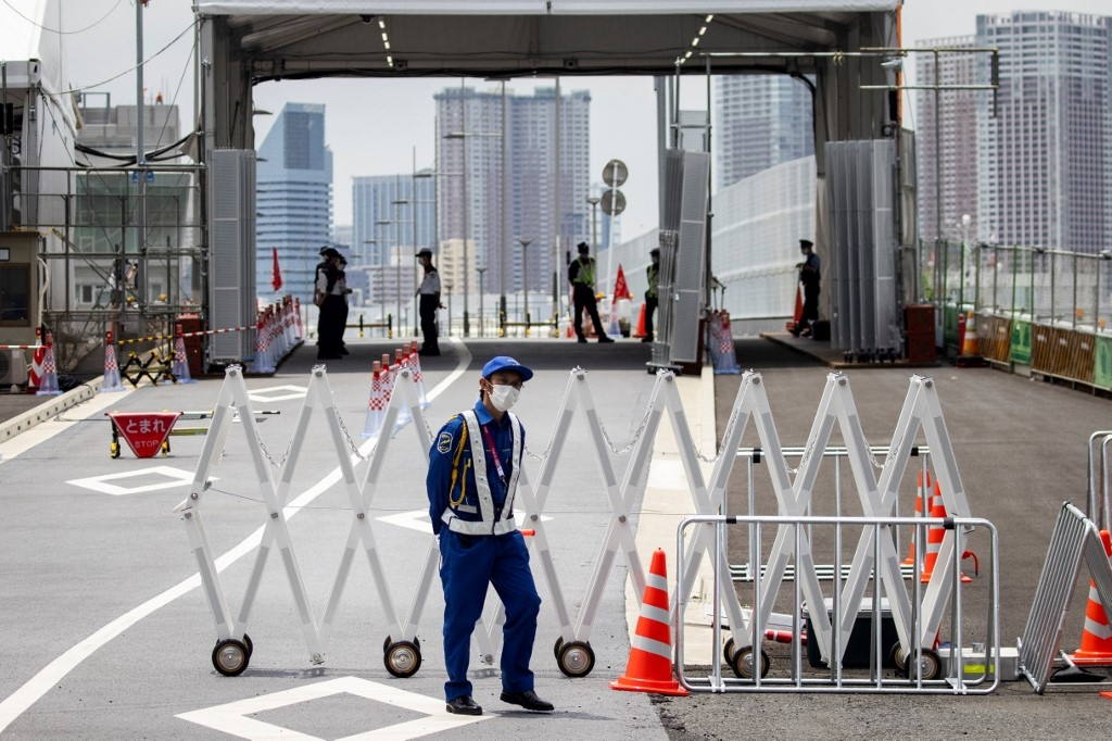 A security personnel stands guard at the entrance of the Tokyo 2020 Olympic and Paralympic Village in Tokyo on July 14, 2021, ahead of the 2020 Tokyo Olympics which begin on July 23. Behrouz MEHRI / AFP