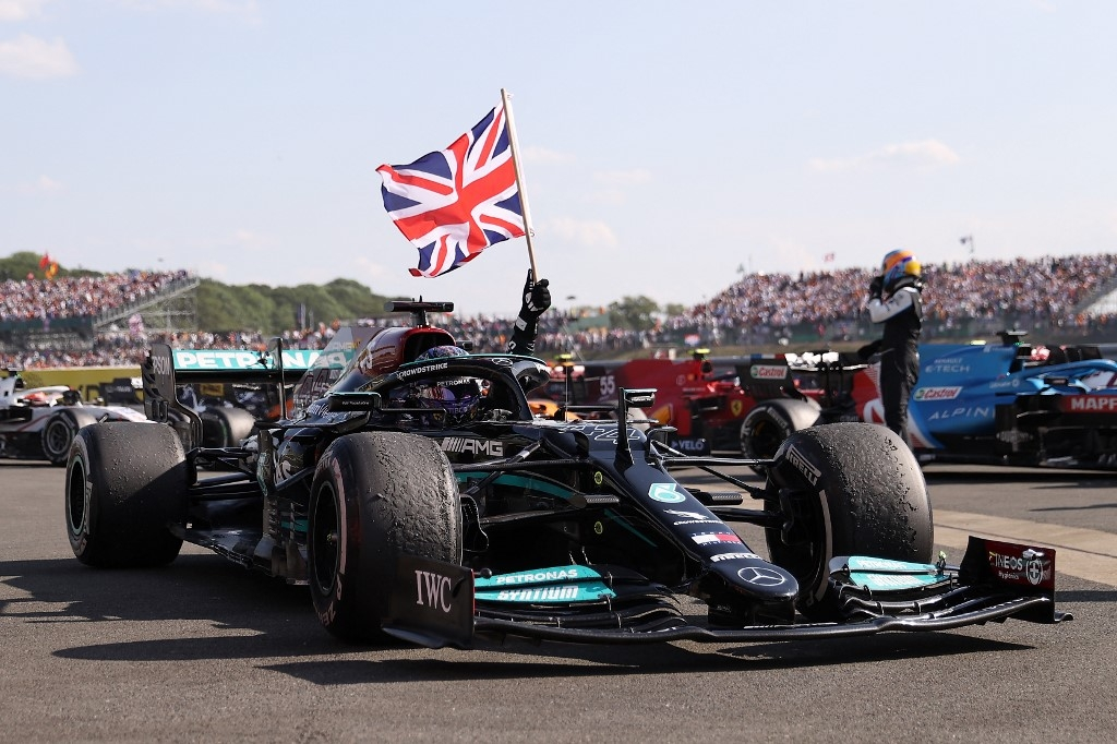 Mercedes' British driver Lewis Hamilton celebrates after winning the Formula One British Grand Prix motor race at Silverstone motor racing circuit in Silverstone, central England on July 18, 2021. LARS BARON / POOL / AFP
