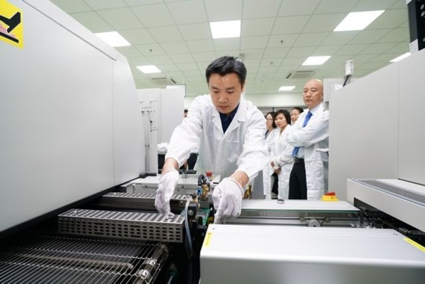 An engineer monitors a production line at a circuit board factory at the Da Nang IT Park. The central city's IZs and IPs have still lured investment in spite of the coronavirus outbreak. (Photo courtesy of Trung Nam Group)