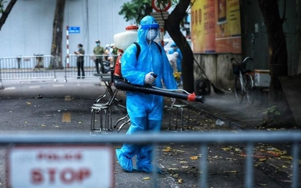 Medical workers disinfect Vong Duc street, downtown Hanoi, after a COVID-19 case was detected here. (Photo: VNA)