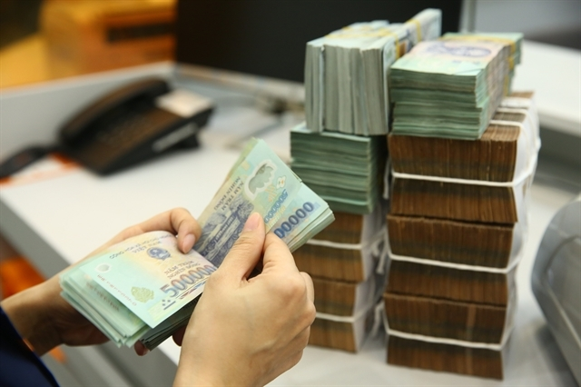 There was a risk that bad debts would increase as the COVID-19 pandemic was hitting enterprises very hard. - Photo nld.com.vn