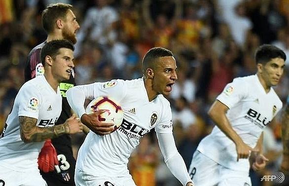 Rodrigo strikes as Atletico held by Valencia in La Liga opener