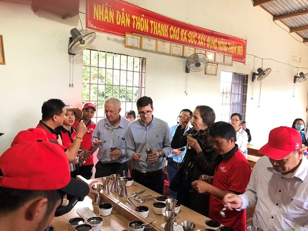 The Swiss ambassador and members of the Embassy team join in a coffee tasting with local farmers in Krong Nang District, Dak Lak Province participating in a Swiss financed project supporting sustainable coffee production. Photo courtesy of Swiss Embassy in Vietnam