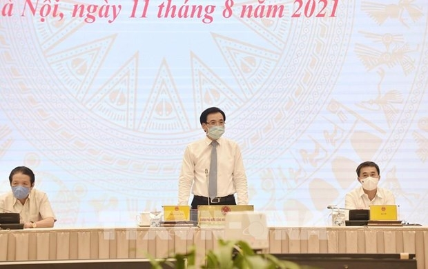 Minister-Chairman of the Government Office Tran Van Son speaks at the Government press conference (Photo: VNA)