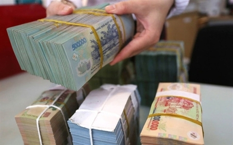 The average overnight interest rate in the trading session ending last week was 0.92 per cent per year, against 1.21 per cent in May. - Photo cafef.vn
