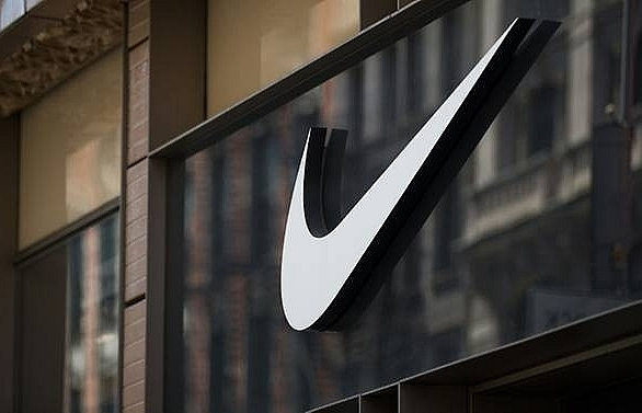 nike touts edgy ads but shares fall on mixed earnings