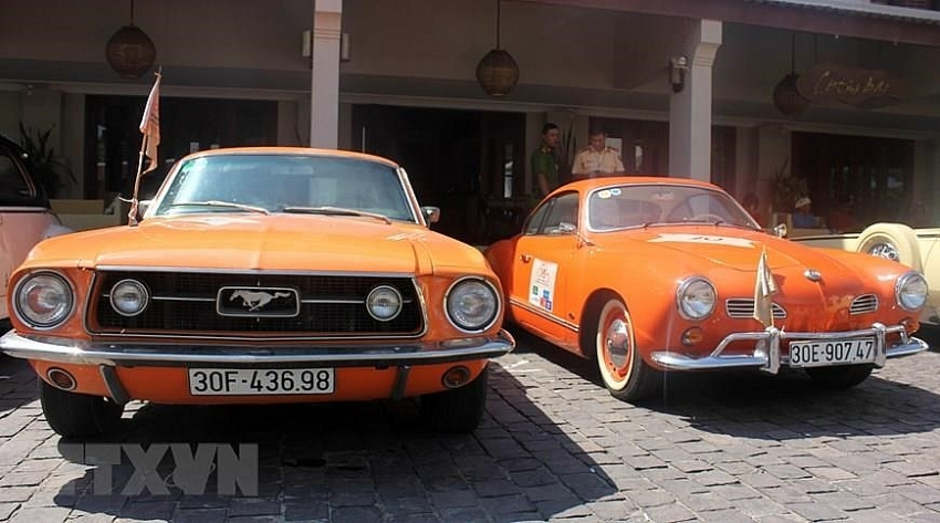 parade of classic cars in hoi an ancient town
