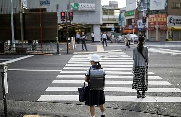 japan raids stores over school uniform cartel