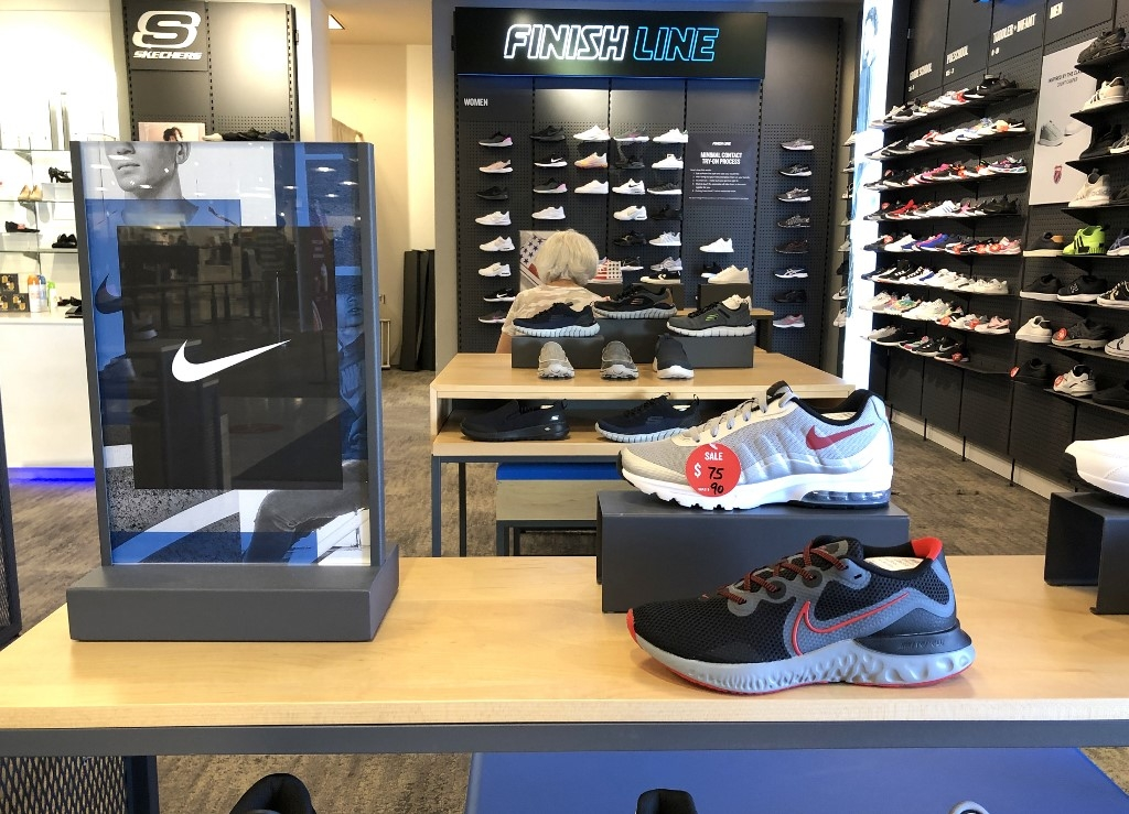 Nike cheers return of pro sports as earnings top expectations