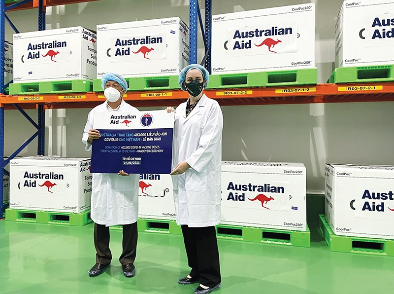 Australia handed over its first 403,000 of 1.5 million COVID-19 vaccine doses to be shared with Vietnam this year