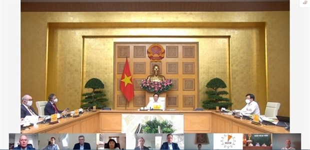 PM Pham Minh Chinh speaks to European diplomats and businesses during an online meeting in Hanoi. (Photo: VNA)