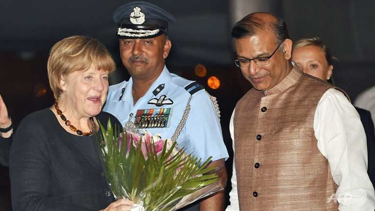 angela merkel lands in india with trade high on the agenda