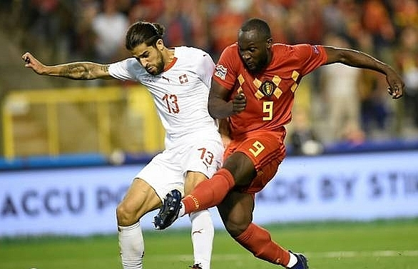 Lukaku strikes twice as Belgium battle past Switzerland