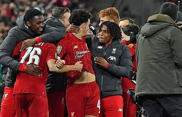 Liverpool reach League Cup quarters after 10-goal thriller against Arsenal