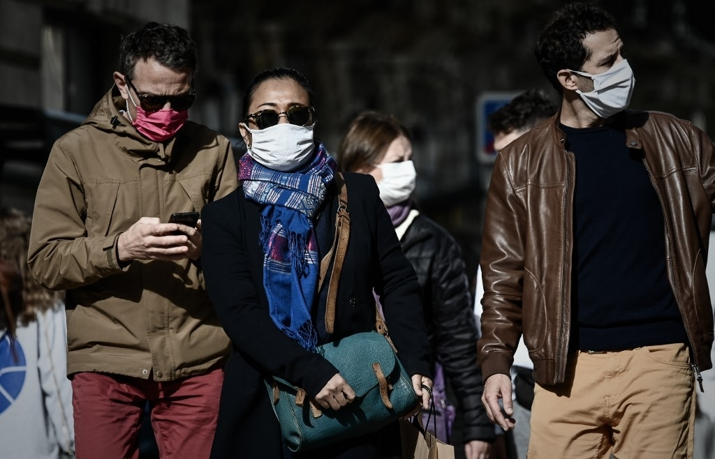 France, Germany impose drastic curbs as virus surges in Europe