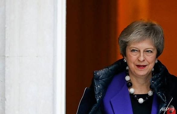 May pays WWI respects in France with Brexit in background