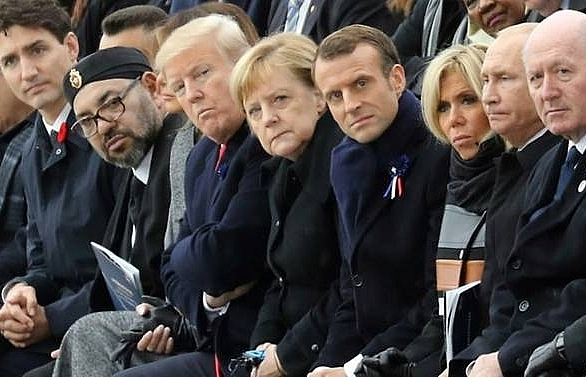 trump putin absent for leaders symbolic walk in paris rain