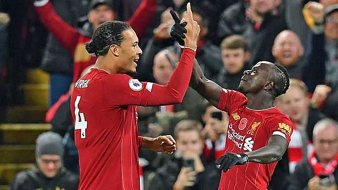 liverpool beat man city to open up eight point premier league lead