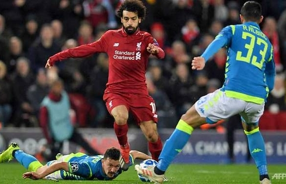 Salah's strike takes Liverpool into last 16 at Napoli's expense
