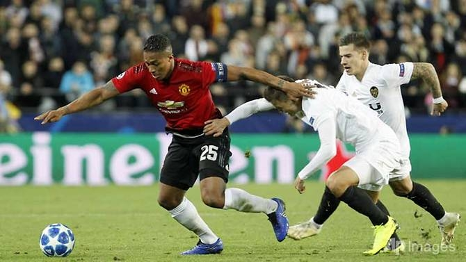 manchester united through as runners up despite defeat to valencia
