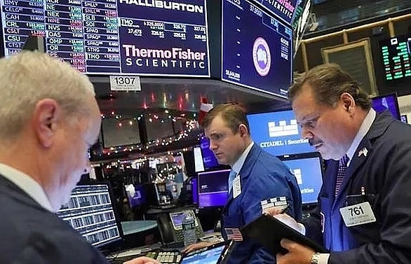 US stocks end at records again as new CEO lifts Boeing shares