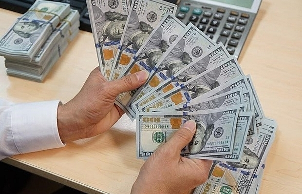 Reference exchange rate down 1 VND on December 26