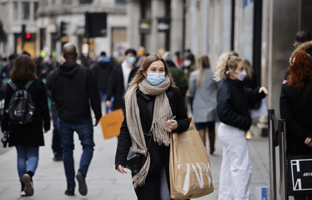 Britain okays vaccine as global Covid death toll nears 1.5 million