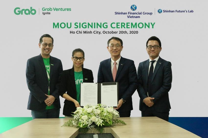 shinhan financial group and grab vietnam sign strategic partnership agreement