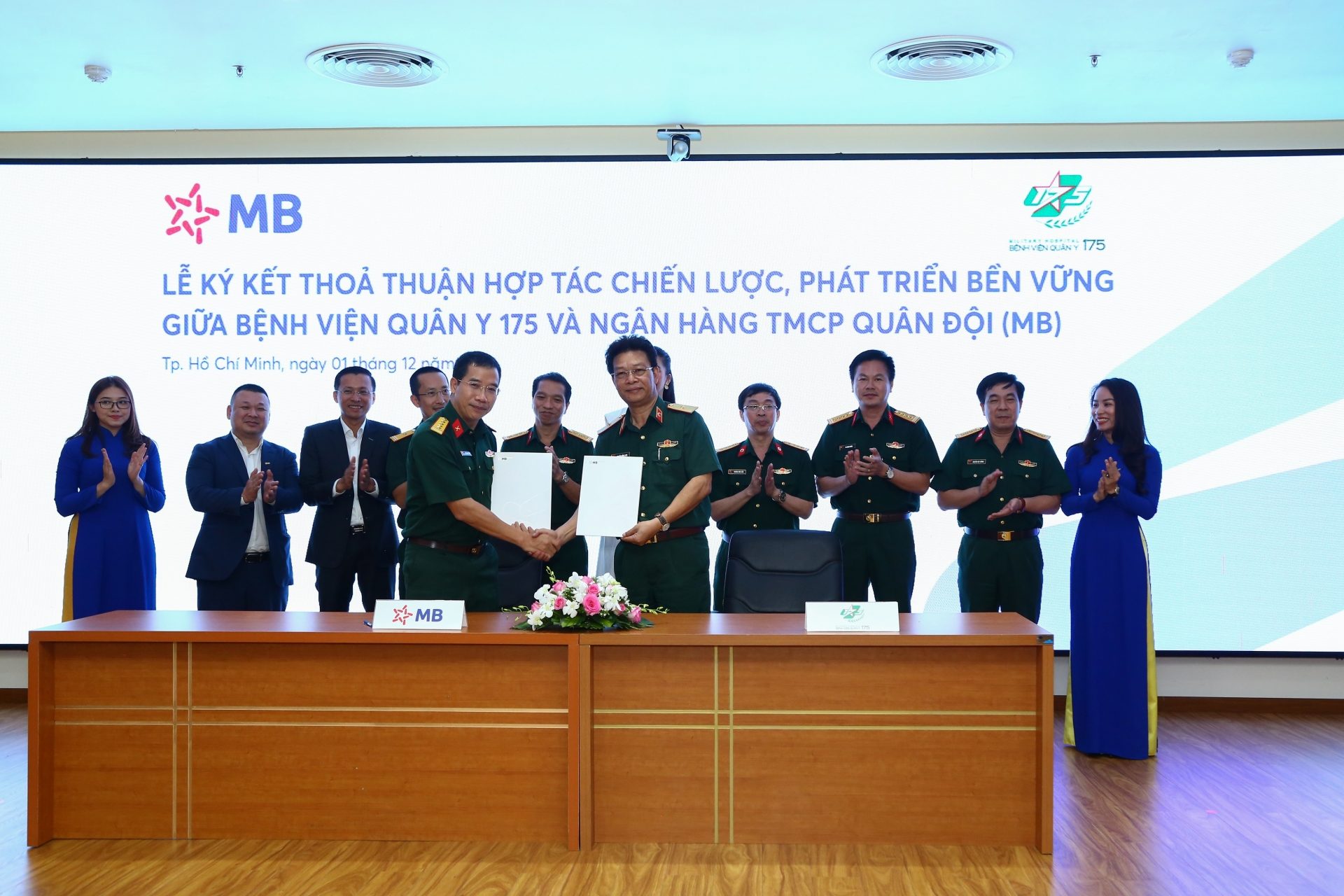 MB and Military Hospital 175 shakes hand to promote cashless payment